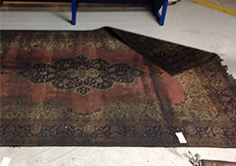 fire-damaged rug